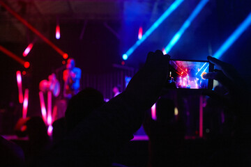 Smartphone video photo recording. Live concert by night.