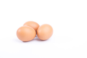 Three fresh hen eggs isolated white background.