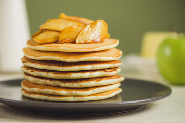 Pancakes with apple on table. Breakfast, snacks. Pancakes Day.