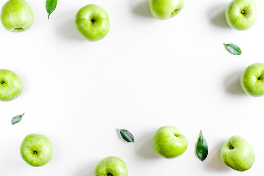 Organic fruits with green apples mock up on white background top view