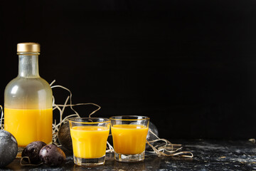 Traditional Italian yellow egg liquor, Bombardino. Dark background. Copy space.