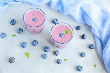 Fresh Cold Blueberry Smoothie in Glass Top View Decorated with Blue Fabric