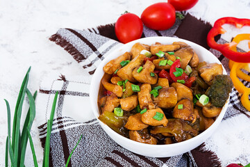 Stir Fry Chicken with peppers and mushrooms on white background