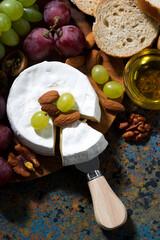 Camembert cheese, fresh fruit and honey, vertical, top view