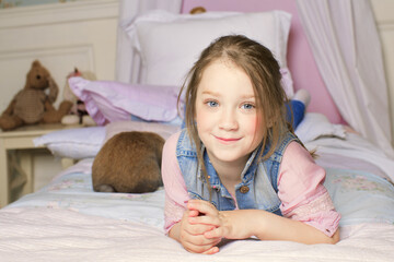shaggy is a young cheerful girl lying on the bed