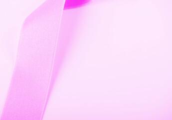 Pink ribbon on white background. Horizontal shoot. Copy space.