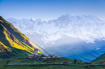 View on Ushguli village at the foot of snow-capped Mt. Shkhara.