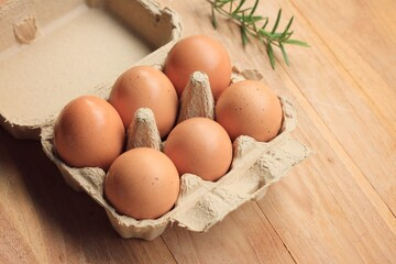 brown egg in box
