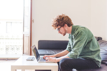 Man millennial using computer working