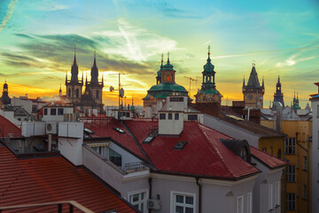 Sunset over the roofs of Prague's buildings, Czech Republic. Cityscape at sunset in the city of Prague