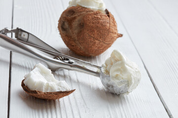Coconut ice cream in a metal spoon