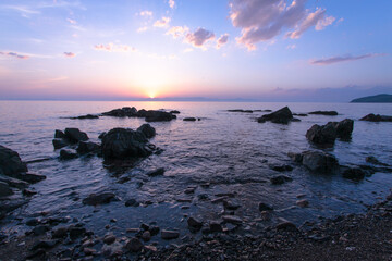Sunset and sea reefs.