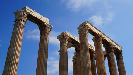 Photo of iconic pillars of Temple of Olympian Zeus with view to the Acropolis and the Parthenon, Athens historic center, Attica, Greece