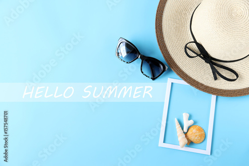 608a5090b77 HELLO SUMMER text woman hat and sunglasses and Shell on blue  background.