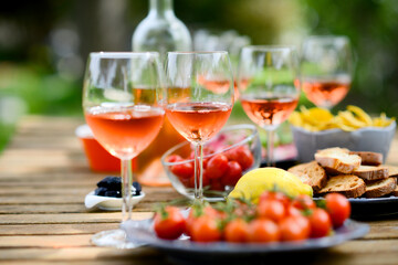 Zelfklevend Fotobehang Buffet, Bar holiday summer brunch party table outdoor in a house backyard with appetizer, glass of rosé wine, fresh drink and organic vegetables