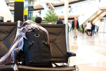 Backpack with woolen scarf at the airport . Travel concept. Backpacker style