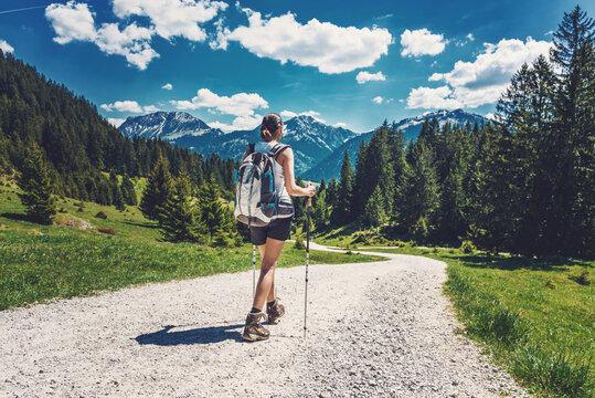 Rear view of woman hiking on a mountain trek