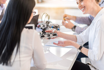 Charming smart ladies testing modern technologies