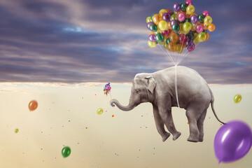Elefant hängt an mehreren Luftballons