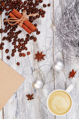 Cup of coffee and coffee beans. Coffee on wooden background. Coffee present for Christmas.