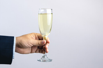 Business man hand holding glass of champagne for celebration