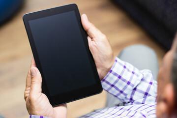 Senior using modern digital tablet