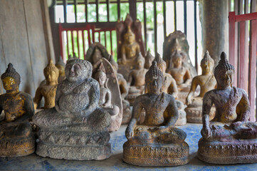 Buddha images inside Ho Trai or the library of Buddhist scriptures (Tripitaka or Pali Canon) located at Wat Mahathat Temple in downtown Yasothon, northeastern (Isan) province of Thailand
