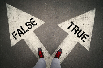 TRUE versus FALSE written on the white arrows, dilemmas concept.
