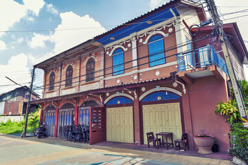 Classic Sino-Portuguese architectural style shophouse building at Ban Singha Tha, old historic area of Yasothon Province in the northeastern region of Thailand
