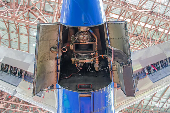 Auxiliary power plant in the tail of the aircraft with open hood covers.