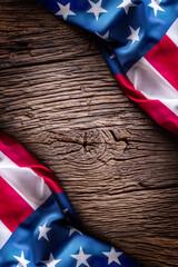 American  Flag. Usa flags on rustic oak board together diagonally.