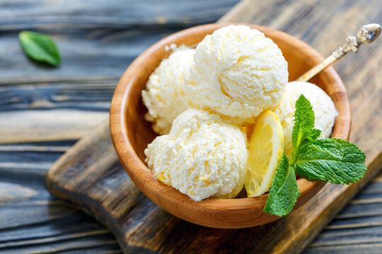 Wooden bowl with homemade lemon ice cream.