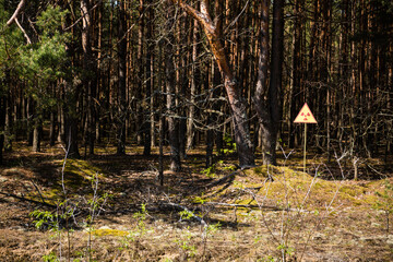 radioactive warning sign at the red forest in chernobyl