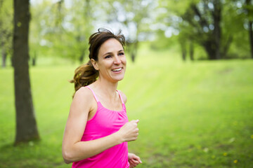 portrait of a woman jogging outdoors