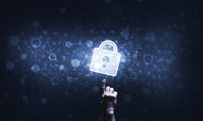 Hand pointing with finger at padlock as concept of internet security and access