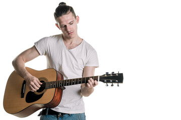 Music and creativity. Handsome young man in t-shirt playing on acoustic guitar. Horizontal frame