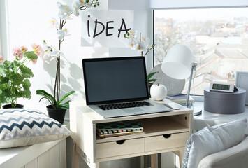 Creative workplace near windowsill in modern room