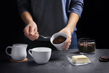 Woman making coffee with butter, closeup