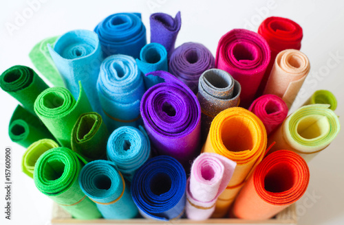 Felt Craft color  Rolls of felt lay on a white background