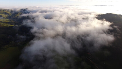 Aerial View of clouds in a Mountain Valley