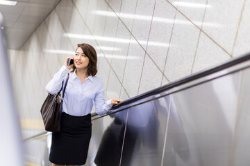 young businesswoman stepping on an escalator