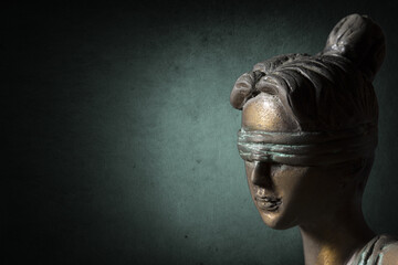 Face of Lady Justice on dark emerald background