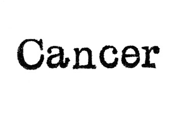 """The word """"Cancer"""" from a typewriter on a white background"""
