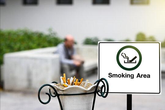 smoking area sign at a park.