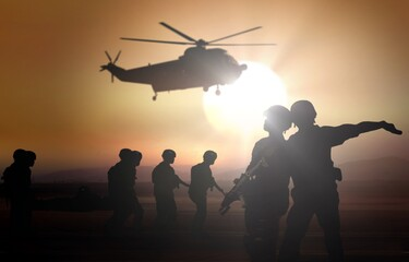 Military helicopter rescue mission at dusk