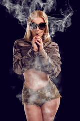 Young sexy woman is vaping
