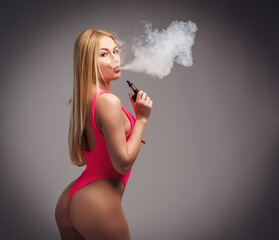 Young sexy blond woman is vaping