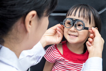 Asian Little Chinese Girl Doing Eyes Examination by ophthalmologist