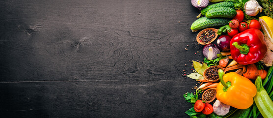 Foto op Canvas Keuken Frame of organic food. Fresh raw vegetables and spices. On a wooden chalkboard.