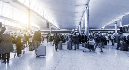 People Travelling at London Airport